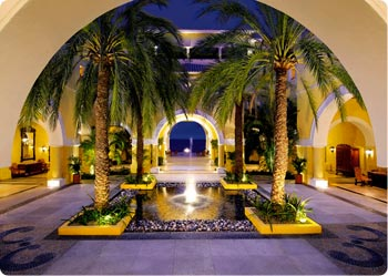 Arched entry to Dreams Los Cabos lobby area