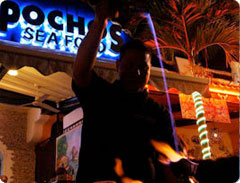 Flambé cooking at Pochos on the Cabo Marina