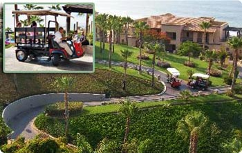 Custom golf carts take resort guests to their rooms and around the property at Sunset Beach Resort, Cabo San Lucas